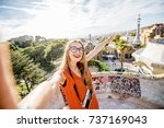 woman tourist in red dress... | Shutterstock . vector #737169043