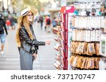 Young Woman Tourist Choosing...