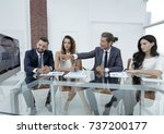business team discussing a new... | Shutterstock . vector #737200177