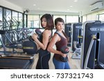two sporty young women pose... | Shutterstock . vector #737321743