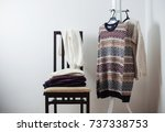 winter clothes on a chair... | Shutterstock . vector #737338753