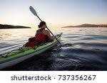 woman on a sea kayak is... | Shutterstock . vector #737356267