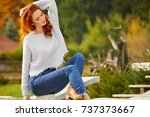 autumn woman in house garden.... | Shutterstock . vector #737373667
