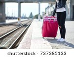 a girl with a pink suitcase is... | Shutterstock . vector #737385133