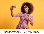 portrait of a smiling afro... | Shutterstock . vector #737473027