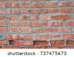 Small photo of An old red brick wall. Vintage abstract background of horizontal brickwork with elements of weather damages and age-related damage at the bottom.