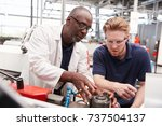 engineer advising a male... | Shutterstock . vector #737504137