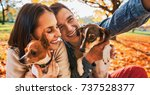 smiling young couple with dogs... | Shutterstock . vector #737528377