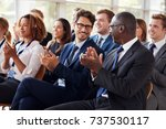audience clapping at business... | Shutterstock . vector #737530117