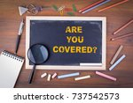 are you covered. on a wooden... | Shutterstock . vector #737542573