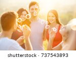 the people blow bubbles on the... | Shutterstock . vector #737543893
