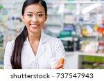 pharmacist in white coat... | Shutterstock . vector #737547943