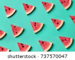 Stock photo colorful fruit pattern of fresh watermelon slices on blue background from top view 737570047