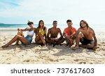 group of young adults drinking... | Shutterstock . vector #737617603