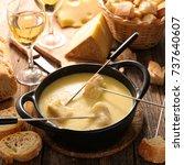 cheese fondue french gastronomy | Shutterstock . vector #737640607