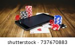 mobile phone with casino tokens ...   Shutterstock . vector #737670883