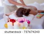 beautiful woman getting salt... | Shutterstock . vector #737674243