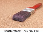 synthetic paint brush on wooden ... | Shutterstock . vector #737702143