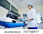 a female scientist near the... | Shutterstock . vector #737708977