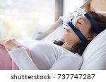 senior woman using cpap machine ... | Shutterstock . vector #737747287