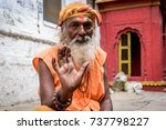 Small photo of October 12,2017. A sadhu Baba posing with blessing hand in Varanasi, Utter Pradesh,India.
