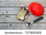 hard hat  gloves and hammer on... | Shutterstock . vector #737805583