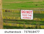 do not feed the horses sign... | Shutterstock . vector #737818477