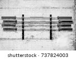 four barbell weight bars on the ... | Shutterstock . vector #737824003