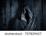 ghostly figure in the dark    Shutterstock . vector #737829427