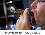 face in profile of man smoking... | Shutterstock . vector #737864077