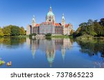 Stock photo new city hall with reflection in the water in hannover germany 737865223