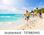 kids playing catch up on sandy... | Shutterstock . vector #737882443