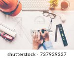 top view architect working on... | Shutterstock . vector #737929327
