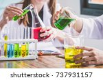 Small photo of Couple of students working at chemistry class. Education concept