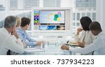 business people looking at... | Shutterstock . vector #737934223