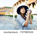 the solo asian female traveler | Shutterstock . vector #737989333