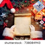 santa claus desk reading wish... | Shutterstock . vector #738084943