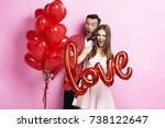 man with balloon embracing his... | Shutterstock . vector #738122647