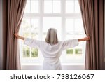 senior woman opening bedroom... | Shutterstock . vector #738126067