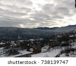Small photo of A sad, gloomy, winter landscape. Art blurry for calendar, almanac.View of the village in the mountains.