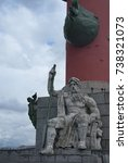 Small photo of SAINT PETERSBURG, RUSSIA - JUNE 26, 2017: South rostral column. The male figure allegorically represents the Volkhov River. Earlier this rostral column was a lighthouse.