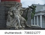 Small photo of SAINT PETERSBURG, RUSSIA - JUNE 26, 2017: South rostral column. The male figure allegorically represents the Dnieper River. Earlier this rostral column was a lighthouse.