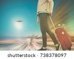 woman carries luggage on... | Shutterstock . vector #738378097