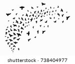 Stock vector silhouette of a flock of birds black contours of flying birds flying pigeons tattoo 738404977