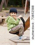 little joyful boy shaking on a... | Shutterstock . vector #73852588