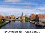 historical dutch houses on a... | Shutterstock . vector #738535573