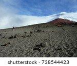 mountaineers ascending towards... | Shutterstock . vector #738544423