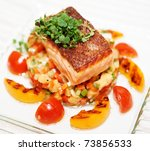 Grilled salmon fillet on glass plate - stock photo