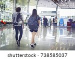 two asian young woman with... | Shutterstock . vector #738585037