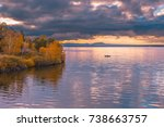 Stock photo beautiful autumn sunrise landscape sailing boat on the lake at burabay national park in northern 738663757